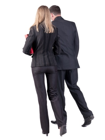 Back view of walking business team  Going young couple  man and woman  with books  beautiful friendly girl and guy in suit go get an education  Rear view people collection  backside view of person  Isolated over white background photo