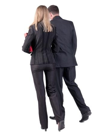 Zur�ck zu Fu� business team gehen junges Paar Mann und Frau mit B�cher sch�nes freundliches M�dchen und Kerl in Anzug gehen eine Ausbildung R�ckansicht Menschen Sammlung R�ckansicht der Person �ber wei�em Hintergrund zu sehen photo