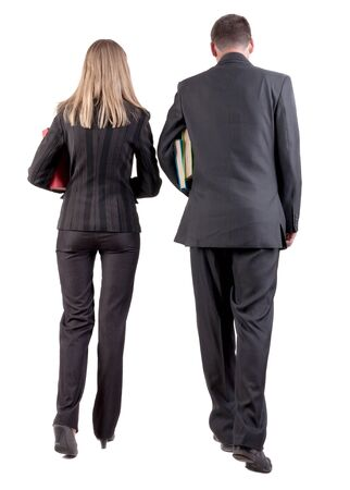 Back view of walking business team  Going young couple in suit with books go get an education  Rear view people collection  backside view of person  Isolated over white background photo
