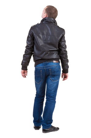 backside: Back view of handsome man in jacket looking thoughtfully into the distance    Standing young guy in jeans and  jacket  Rear view people collection   backside view of person   Isolated over white background