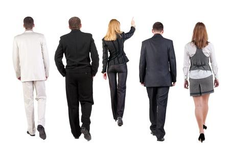 caminando: Vista posterior del grupo de caminantes equipo de negocios de los empresarios va Vista trasera Vista trasera gente colecci�n de persona aislada sobre fondo blanco Foto de archivo