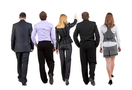 back view of walking business team   business people going  woman pointing in distance  Rear view people collection  backside view of person  Isolated over white background
