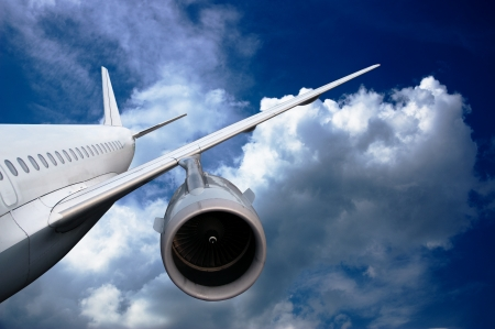 airliner: airplane flying down  against the sky   landing or crash of airplane