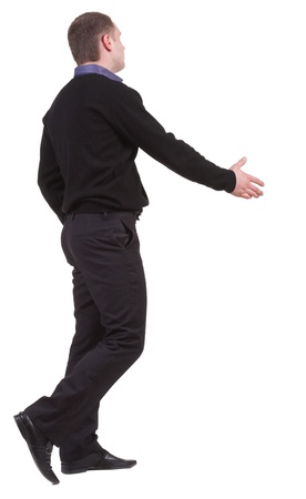 back view of businessman in  movement reaches out to shake hands. Rear view people collection. backside view of person. Isolated over white background. photo