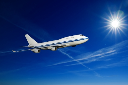 passenger airplane in the clouds. travel by air transport. flying to the top of the airliner. nobody