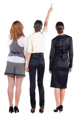 Back view of three beautiful young bussineswoman looking. Rear view people collection.  backside view of person.  Isolated over white background. photo