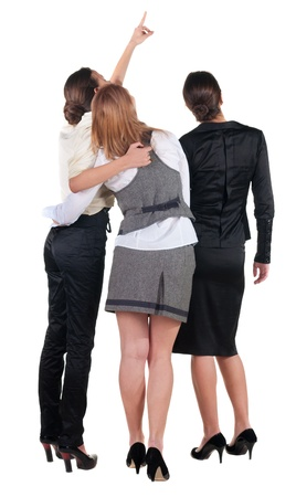 back view of business team. three young  woman pointing.  Rear view people collection.  backside view of person.  Isolated over white background. photo