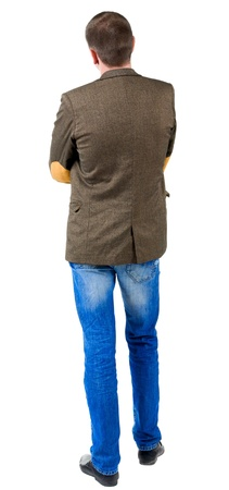 looking behind: Back view of business man in jacket with patches on the sleeves .  looking ahead of yourself. Isolated over white background.  Standing young guy in jeans and suit jacket. Rear view people collection.  backside view of person. Stock Photo