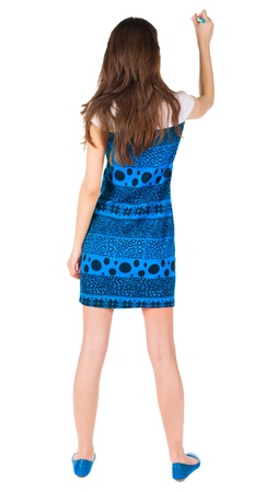 beautiful brunette: back view of writing beautiful brunette woman. Young girl in blue dress draws. Rear view people collection.  backside view of person. Isolated over white background.