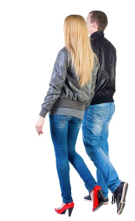Back view of going young couple (man and woman) . walking beautiful friendly girl and guy in jacket and jeans together. Rear view people collection.  backside view of person.  Isolated over white background. photo