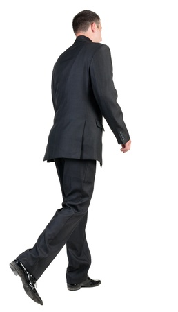 back view of walking  business man.  going young guy in black suit. Isolated over white background. Rear view people collection.  backside view of person. photo