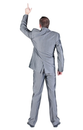 Back view of businessman pointing at wall. Rear view people collection.  backside view of person.  Isolated over white background. photo