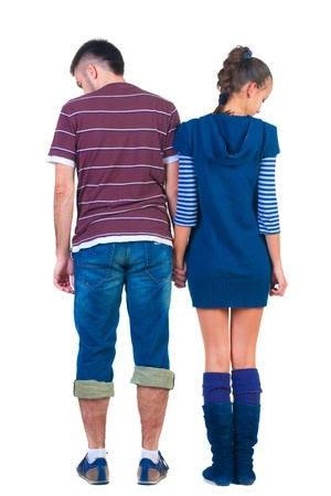 Sad young pair. Rear view people collection.  backside view of person.  Isolated over white background. photo