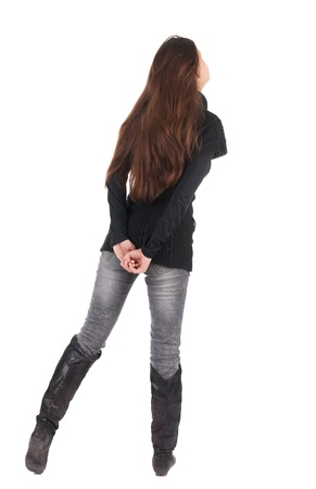 back view of standing young beautiful  woman.  blonde girl in jeans and sweater watching;. Rear view people collection.  backside view of person.  Isolated over white background. photo