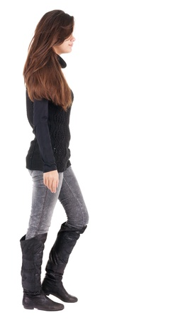 back view of walking  woman  in  gray jeans. beautiful brunette girl in motion.  backside view of person.  Rear view people collection. Isolated over white background. photo