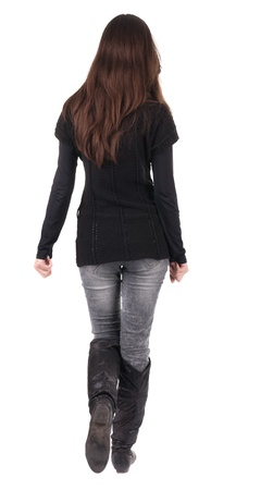 black sweater: back view of going  woman  in  in jeans and black sweater. beautiful brunette girl in motion.  backside view of person.  Rear view people collection. Isolated over white background.