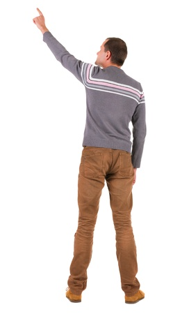 Back view of  pointing young men in  sweater and jeans. Young guy  gesture. Rear view people collection.  backside view of person.  Isolated over white background.  photo
