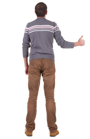 Back view of  man in sweater shows thumbs up.   Rear view people collection.  backside view of person.  Isolated over white background. photo