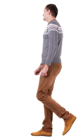 man rear view: Back view of walking   man in sweater and brown jeans.   young guy in jeans and  jacket. Rear view people collection.  backside view of person.  Isolated over white background.