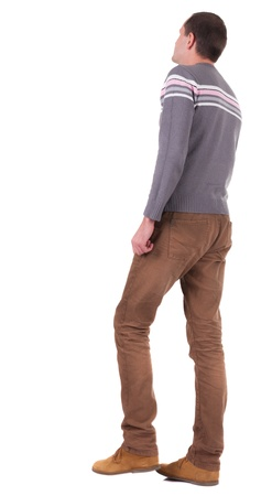 Back view of going   man in  brown jeans and shoes.  walking young guy in jeans and  jacket. Rear view people collection.  backside view of person.  Isolated over white background. photo