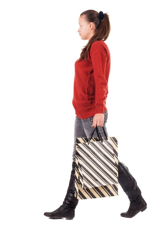 back view of going woman with shopping bags . beautiful brunette girl in motion. backside view of person. Rear view people collection. Isolated over white background.