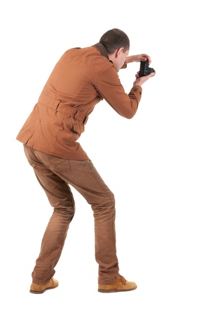 Back view of man photographing.   stylishly dressed in casual clothes photographer. Rear view people collection.  backside view of person.  Isolated over white background. Stock Photo