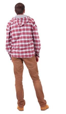 Back view of guy in a plaid shirt with hood  looking. Standing young guy in jeans and  jacket. Rear view people collection.  backside view of person.  Isolated over white background. photo