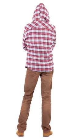 back  view: Back view of guy in a plaid shirt with hood  looking. Standing young guy in jeans and  jacket. Rear view people collection.  backside view of person.  Isolated over white background.