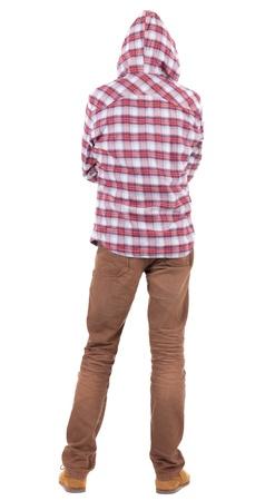 personnes de dos: Vue arri�re du gars dans une chemise � carreaux avec capuche recherche. Permanent jeune homme en jeans et une veste. Vue arri�re gens collection. vue arri�re de sa personne. Isol� sur fond blanc.