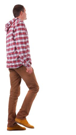 Back view of going  guy in a plaid shirt with hood.  walking young guy in jeans and  jacket. Rear view people collection.  backside view of person.  Isolated over white background. Stock Photo - 16306174