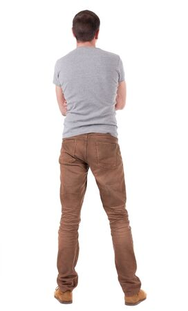 Back view of handsome man in shirt and jeans  looking up.   Standing young guy. Rear view people collection.  backside view of person.  Isolated over white background. Stock Photo - 16306194