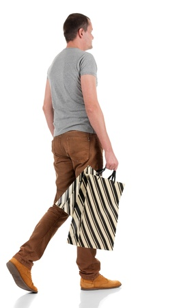 Back view of going  handsome man with shopping bags.  walking young guy in jeans and  jacket. Rear view people collection.  backside view of person.  Isolated over white background. Stock Photo - 16306162