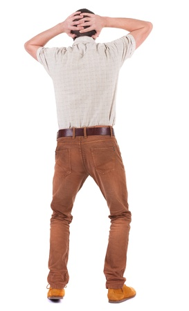 Back view of angry young man in jeans and shirt. Rear view. isolated over white. backside view of person.  Rear view people collection. Isolated over white background. photo