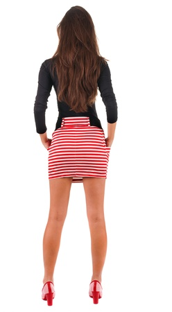 see side: back view of standing young beautiful  woman.  blonde girl in red dress and  kitten heels watching. Rear view people collection.  backside view of person.  Isolated over white background.