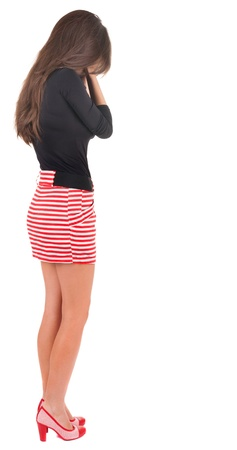 shot from behind: back view of crying young beautiful  woman.  brunette girl in blue dress and  kitten heels.  Rear view people collection.  backside view of person.  Isolated over white background.