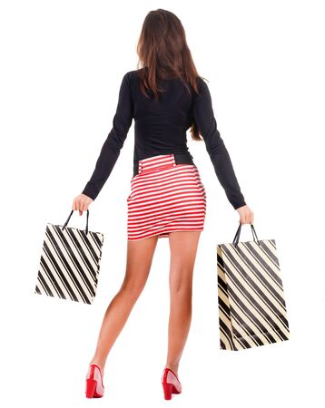 back view of going  woman  in  dress woman with shopping bags . beautiful brunette girl in motion.  backside view of person.  Rear view people collection. Isolated over white background. Stock Photo - 16306250