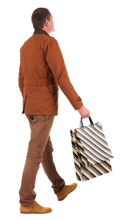 Back view of going  handsome man with shopping bags.  walking young guy is shopping. Rear view people collection.  backside view of person.  Isolated over white background. photo
