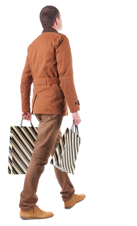 Back view of going  handsome man with shopping bags.  walking young guy is shopping. Rear view people collection.  backside view of person.  Isolated over white background. Stock Photo - 16306244