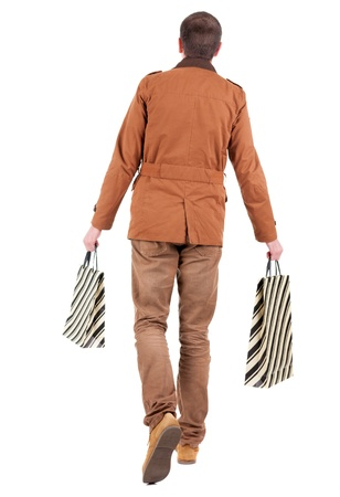 Back view of going  handsome man with shopping bags.  walking young guy is shopping. Rear view people collection.  backside view of person.  Isolated over white background. Stock Photo - 16306143