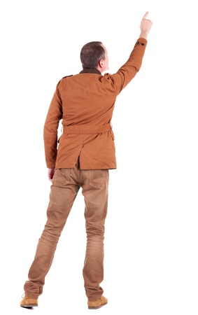 Back view of  man in jacket  pointing. Young handsome guy in jeans and  jacket showing. Rear view people collection.  backside view of person.  Isolated over white background. photo