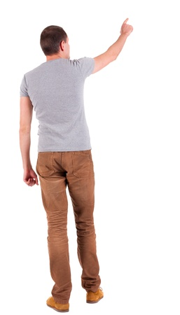 Back view of  pointing young men in  shirt and jeans. Young guy  gesture. Rear view people collection.  backside view of person.  Isolated over white background.  photo