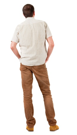 Back view of handsome man in shirt  looking up.   Standing young guy in jeans and  jacket. Rear view people collection.  backside view of person.  Isolated over white background. Stock Photo - 17213499