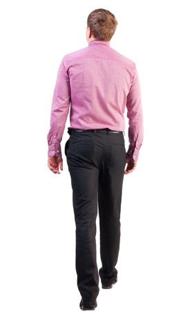 Back view of going  handsome business man in pink shirt  walking young businessman photo