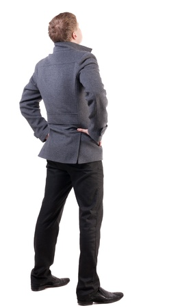 back view of Business man  looks ahead. Young guy in coat watching.  Rear view people collection.  backside view of person.  Isolated over white background. photo