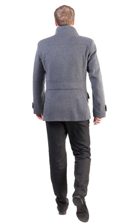 Back view of going  handsome business man in coat.  walking young businessman . Rear view people collection.  backside view of person.  Isolated over white background. Stock Photo - 18421116