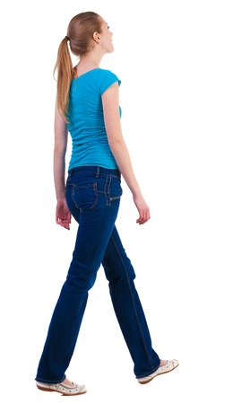 people from behind: back view of walking  woman  in   jeans and shirt. beautiful blonde girl in motion.  backside view of person.  Rear view people collection. Isolated over white background.