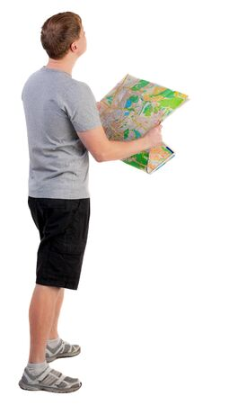 Back view of  journey  young man looking at the map. travelers man in shorts consider recreation. Rear view people collection.  backside view of person.  Isolated over white background. photo