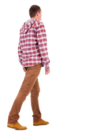 Back view of going  guy in a plaid shirt with hood.  walking young guy in jeans and  jacket. Rear view people collection.  backside view of person.  Isolated over white background. photo
