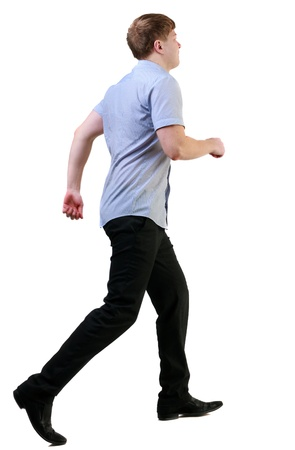 back view of running business man . walking businessman in motion. Rear view people collection.  backside view of person. Isolated over white background. photo