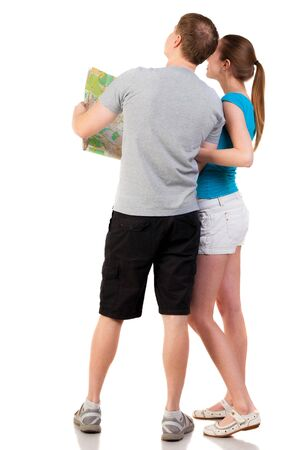 Back view journey of the young couple looking at the map. travelers man and a woman in shorts consider recreation.. Rear view people collection.  backside view of person.  Isolated over white background. photo